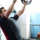 Man Exercising His Arm Muscles By Lifting Two Dumbell Free Weights In a Fitness Club. - VideoHive Item for Sale