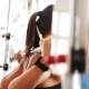Of Young Woman With Barbell Flexing Muscles In Gym With Smart Watch - VideoHive Item for Sale