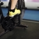 Side View  Part Of Young Man In Sports Shoes Cycling At Gym. Slider Shot - VideoHive Item for Sale