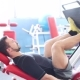 Attractive Young Man Doing Leg Press On Machine In Gym - VideoHive Item for Sale