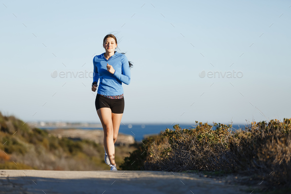 Sport runner jogging on beach working out - Stock Photo - Images