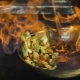 Chef Frying Vegetables. Cognac is Ignited in the Pan. Open Fire in the Kitchen - VideoHive Item for Sale