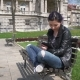 Student Girl Working With a Tablet Pc in a Green Park  - VideoHive Item for Sale