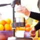 The Man On The Juicer Squeezes Out Juice - VideoHive Item for Sale