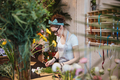 Woman florist making bouquet and working in flower shop - PhotoDune Item for Sale