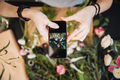 Woman florist taking pictures of flowers with mobile phone - PhotoDune Item for Sale