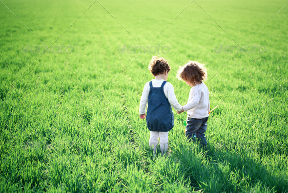 Children in spring field - Stock Photo - Images