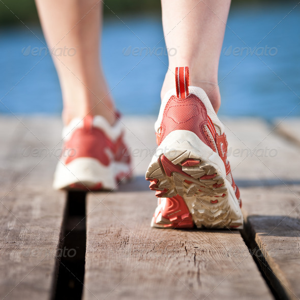 Feet of jogging person - Stock Photo - Images
