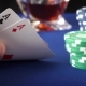 Two Aces In Hand And Gambling Chips On Casino Blue Felt - VideoHive Item for Sale