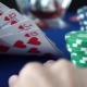 Royal Flush In Hand And Gambling Chips On Casino Blue Felt - VideoHive Item for Sale
