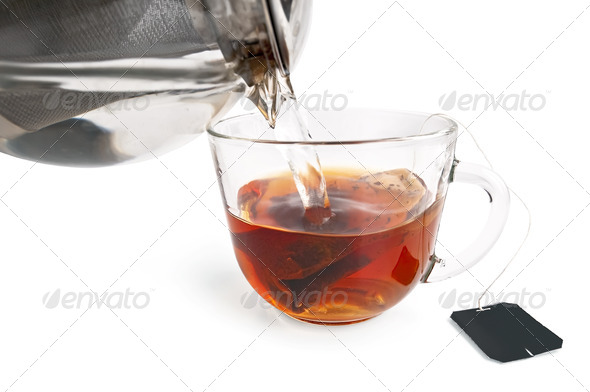 Tea from a bag in a glass cup with a teapot - Stock Photo - Images