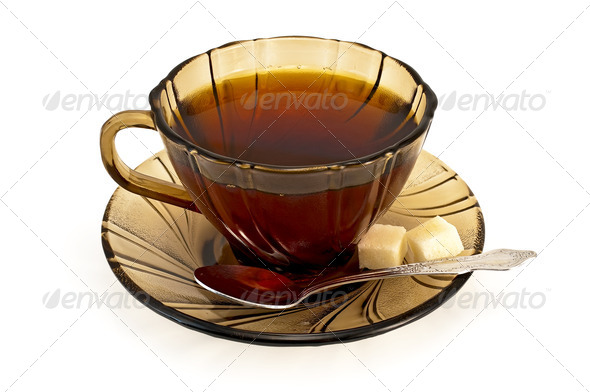 Tea in a cup with a spoon of brown sugar and - Stock Photo - Images