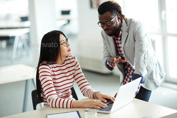 Talking to secretary - Stock Photo - Images