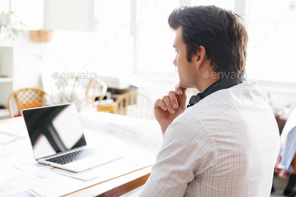 Young businessman in office - Stock Photo - Images