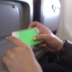 Woman Hand Using Cell Phone In Airplane - VideoHive Item for Sale