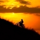 On The Way To Achieve The Goal. Motocross Bike At Sunset On Hill Climbs.  - VideoHive Item for Sale