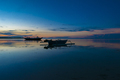Sunset with fisher boat and still water on Gili Air Island, Indo - PhotoDune Item for Sale