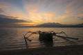 Sunrise with tourist boat and still water on Gili Air Island, In - PhotoDune Item for Sale