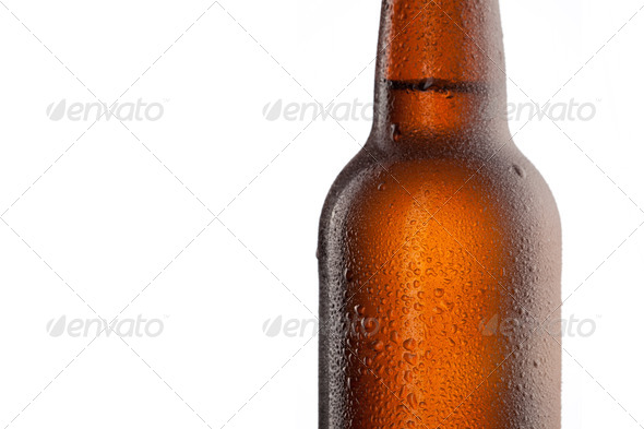 Beer bottle with water drops and frost isolated on white - Stock Photo - Images