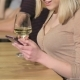 Of a Young Woman Uses Smartphone At The Bar - VideoHive Item for Sale