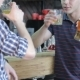 Of Three Friends Drinking Beverages At The Bar - VideoHive Item for Sale