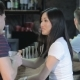 Asian Girl Drinks Red Wine While Man Drinks Whiskey - VideoHive Item for Sale
