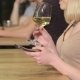 Of a Young Woman Drinks Wine Holding Phone In Her Hand - VideoHive Item for Sale