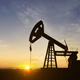 Silhouette Of Crude Oil Pump At Sunset In Oil Field - VideoHive Item for Sale