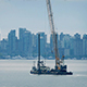 Barge Transporting Crane Near City Waterfront - VideoHive Item for Sale