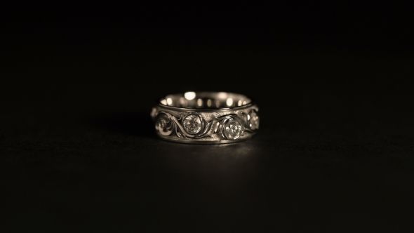 Jewel White Gold Ring Rotates A Black Background by kvrzt
