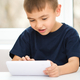 Young boy is using tablet - PhotoDune Item for Sale