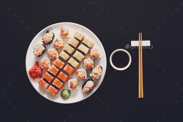 Set of sushi maki and rolls at black background - Stock Photo - Images