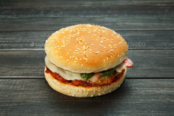 Meet and cheese burger at rustic wood - Stock Photo - Images