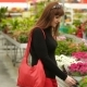 Girl Chooses Flowers In The Store - VideoHive Item for Sale