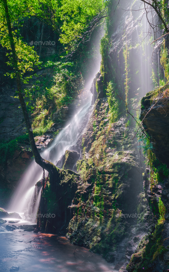 Sunbeams through the waterfall - Stock Photo - Images