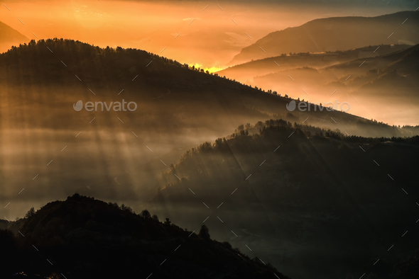 Light of the morning betwen the mountains - Stock Photo - Images