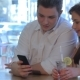 Man And Woman Looks At The Smartphone - VideoHive Item for Sale