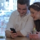Woman Laughs Looking At The Man's Phone - VideoHive Item for Sale