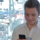 Of Man Uses Cellphone At The Cafe - VideoHive Item for Sale
