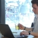 Man Uses Laptop At The Cafe - VideoHive Item for Sale