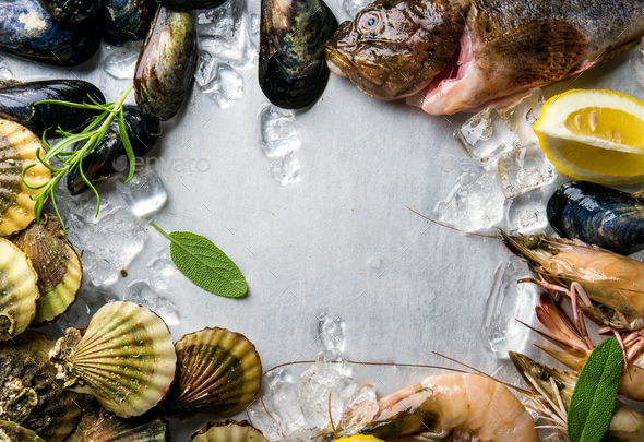 Fresh seafood with herbs and lemon on ice - Stock Photo - Images