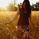 Woman Walking In a Wheat Field - VideoHive Item for Sale