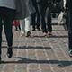 People Cross a Crosswalk