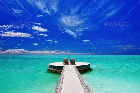 Two deck chairs on stunning tropical beach - Stock Photo - Images