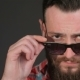 Young Hipster Corrects His Sun Glasses - VideoHive Item for Sale