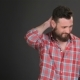 Bearded Man Scratches His Back Of The Neck - VideoHive Item for Sale