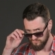 Bearded Man Lowers His Sunglasses - VideoHive Item for Sale