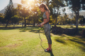 Fit young woman with skipping rope outdoors at the park