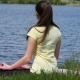 Young Woman Relaxing Meditating On The Beach Beside The River  - VideoHive Item for Sale
