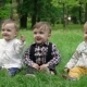 Three Children On The Grass On Which The Petals Are Falling From The Trees,  - VideoHive Item for Sale